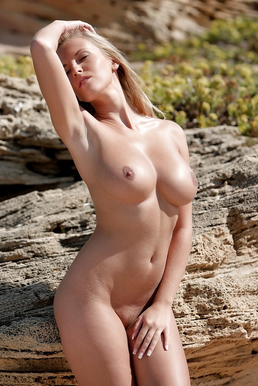 busty-pornstar-spreading-her-legs-in-the-sand-02