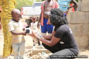 Nikki-Laoye-giving-a-toy-to-a-displaced-child