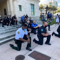Miami-Area Police Join Protesters To Pray Amid George Floyd Unrest In USA