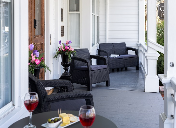 Maine_Stay_Inn_Exteriors_Front_Porch_with-wine