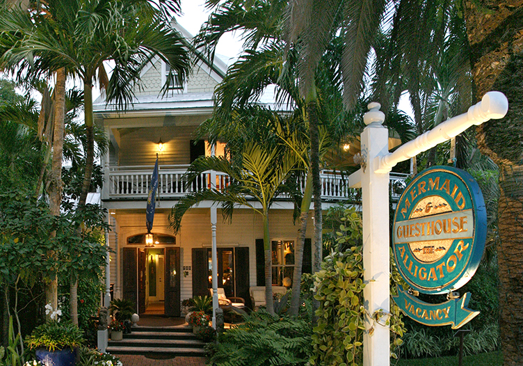 the mermaid and the alligator exterior view of the beautiful key west property tucked away in tall palm trees