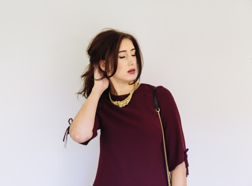Ted Baker top. Elyona necklace. Ted Baker handbag.
