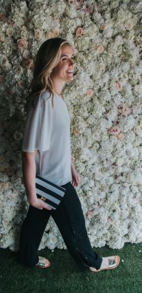 Tibi one-should top. Ted Baker clutch. Tibi black pants.