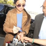 Selena Gomez shows off her toned stomach as she catches a flight out of Los Angeles amidst reports she's back with Justin Bieber and that she was seen with One Direction's Niall Horan.