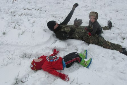 Making snow angels! Nathanael's shirt rode up and his back got cold & wet. Brr. :(
