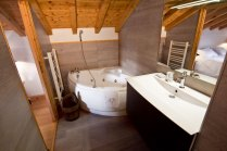 Luxury ski holiday with jacuzzi spa baths and hammam steam shower.
