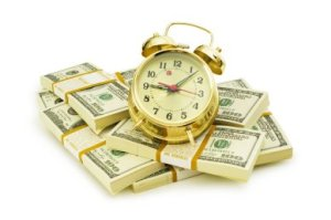 Time is money concept with dollars and clock