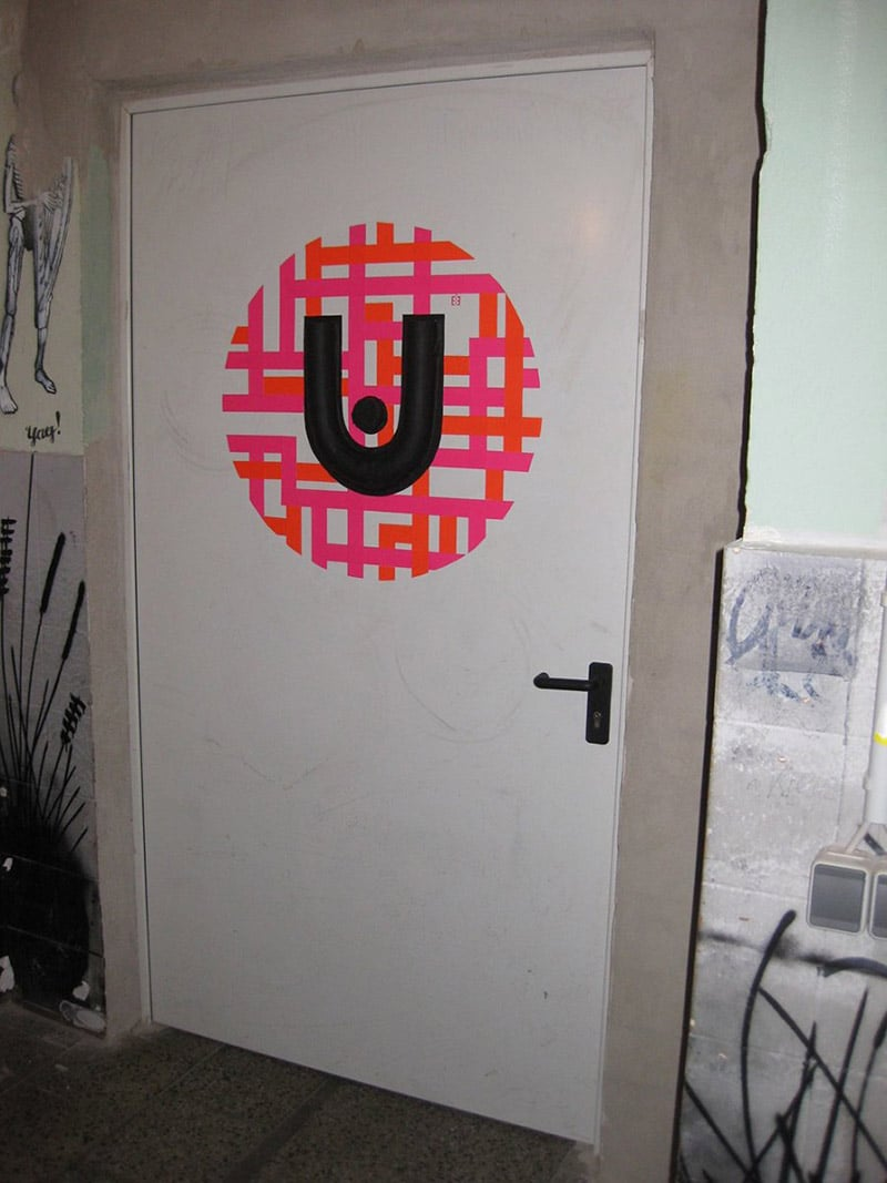 urban spree logo as duct tape graffiti on the door