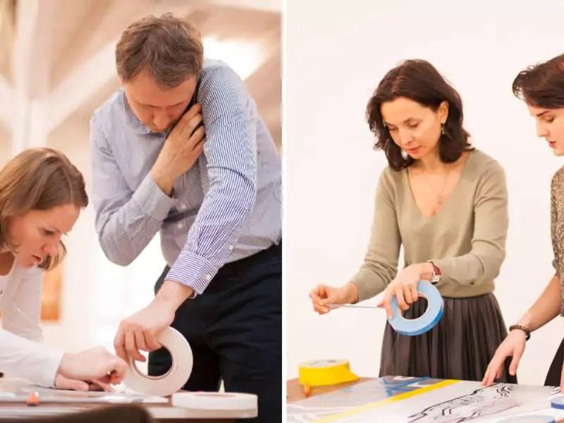 Teilnehmer kleben mit Begeisterung-Team-building-Workshop-Selfmadecrew