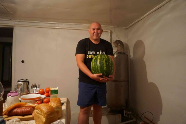 My Kyrgyz brother, Mirlan, and a massive melon.