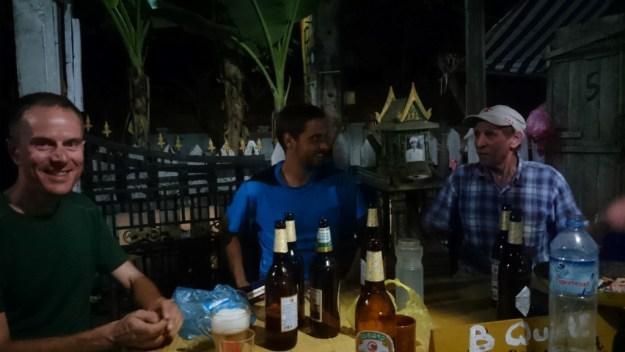 With cyclist Marc and friend John at Spic Laos hostel, Luang Prabang. Photo credit: D. Tan