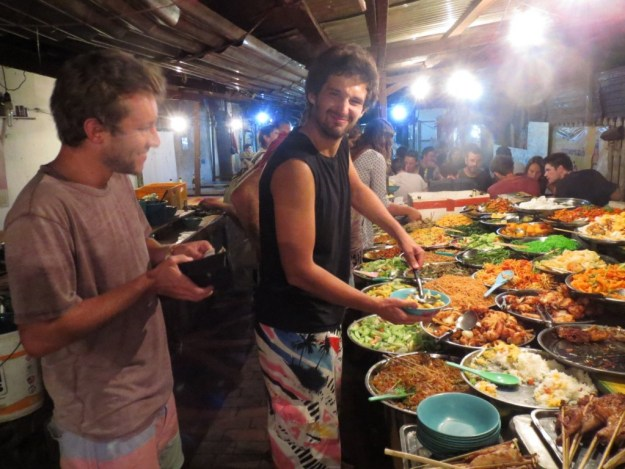 Francis & Chris loading up at the 'all you can fit on a plate' buffet in the nightmarket, Luang Prabang