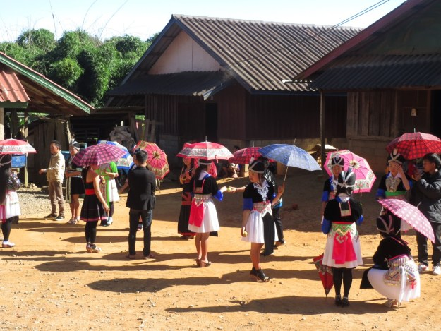 My journey north of Vang Vieng coincided with the Mon people's new year celebrations. Colourful dresses and ball games were on display everywhere.