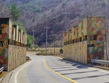 These blocks were found along the roads near the DMZ. They are wired to charges which would be detonated in the event of a North Korean invasion, tumbling the blocks into the road to stop advancing enemy tanks.