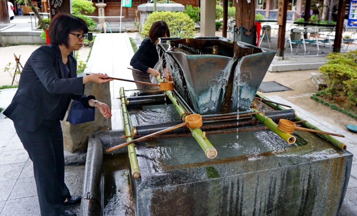 Ritual handwashing before Buddhist prayers at Kushida Shrine, Fukuoka
