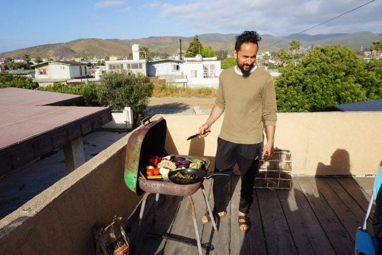 Chema doing a vegan barbecue on the terrace.