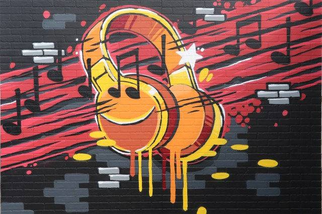 boyband tv show set scenic paint graffiti style spraypaint wall headphones july 2017
