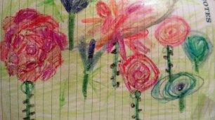 This a patch of different style roses and bluebells