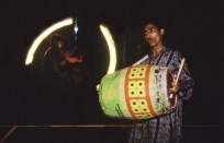 fire spinner and drummer