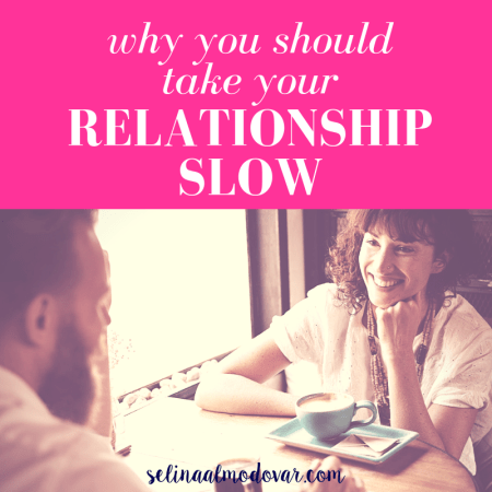 "curly haired girl smiles at man sitting across from her as they sit at a table with cups of coffee with pink overlay and white text that reads, ""Why You Should Take Your Relationship Slow"""