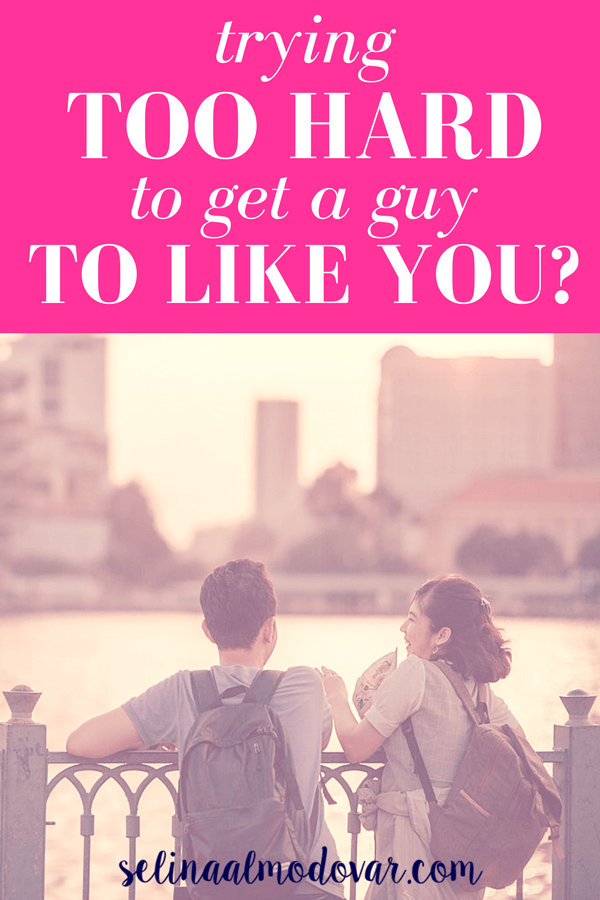 """girl laughing at guy as they overlook a river while standing on a bridge with pink overlay and white text reading, """"Trying Too Hard to Get a Guy to Like You?"""""""