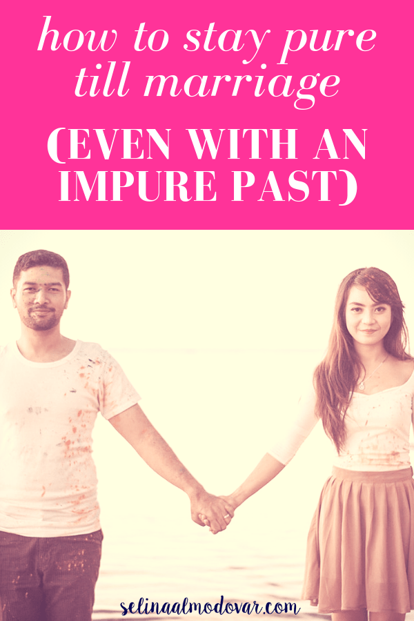 man and woman wearing paint stained clothing stands apart while holding hands with pink overlay and white text that reads,