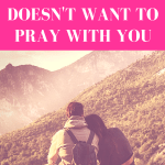 "couple sitting on stone wall overlooking jungle/mountain view while girl rest head on guy's shoulder with pink overlay and white text that reads, ""When Your Man Doesn't Want to Pray with You"""