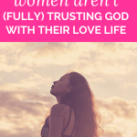 """woman with long hair looks up at a cloudy sky while closing her eyes with pink overlay and white text that reads, """"Why Christian Women Aren't (FULLY) Trusting God With Their Love Life"""""""