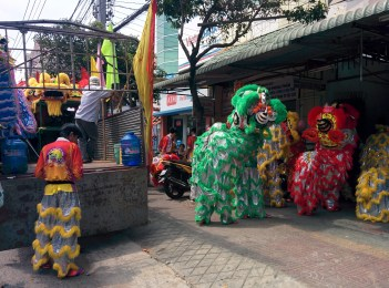 Lion dancers entering a house to perform.