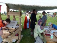 Re-enactors doing wood block printing.