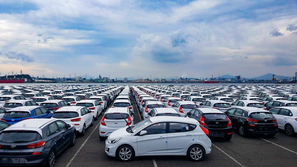 Sea of cars at a car factory