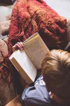reading a book with a cozy blanket