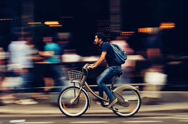 man riding bike to work