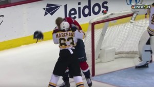 Boston Bruins forward Brad Marchand and Washington Capitals forward Lars Eller engaging in the first fight of the 2018-19 NHL season