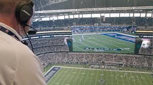 NFL ATC spotter observing game from stadium booth