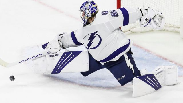 Andrei Vasilevskiy makes a save against the Carolina Hurricanes in Game 1 of the second round of the 2021 Stanley Cup Playoffs. (By Dirk Shadd | Times, from Tampa Bay Times)
