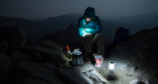 Brendan Leonard waits for his Good To Go meal to cook near midnight on top of Mount Bierstadt.
