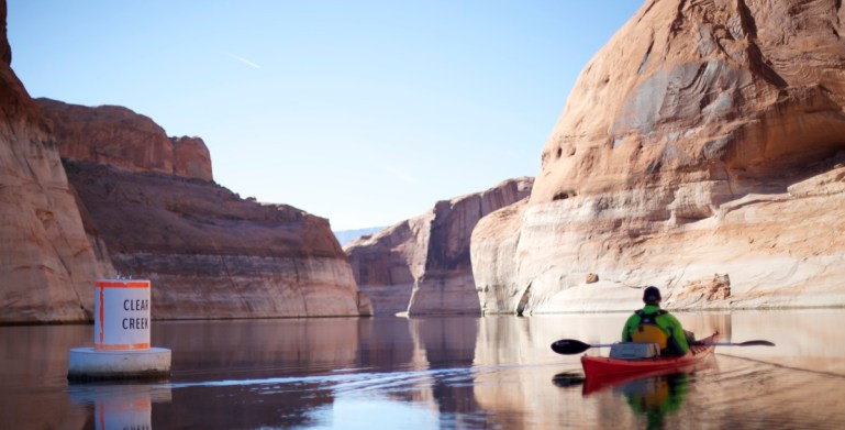 paddling in clear creek in glen canyon