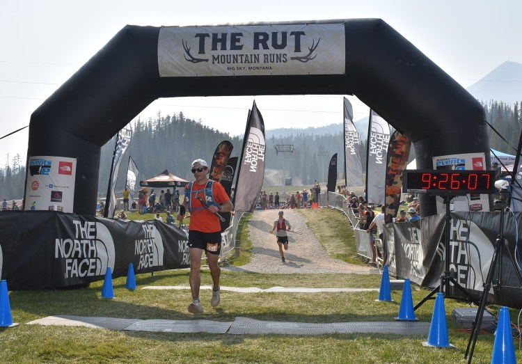 photo of runner crossing the finish line of the 2021 Rut 50K