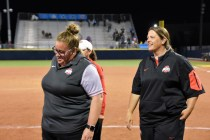Coach Kelly (right) and Coach Jenna smile after a big victory