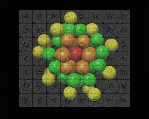 Visualization of the atomic structure of a gold nanoparticle determined by electron microscopy. The colored spheres denote gold atoms in different crystal shells around the central axis (red). The background shows a collection of real-life electron microscopy data from which the single structure shown was reconstructed. (Source: Stanford) University.