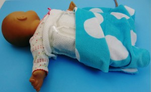 """New wearable electronics will allow an infant to be swaddled in a blanket laced with a network of nearly weightless, printed """"coils"""" for more comfortable, less expensive MRI scanning. (Source: UC Berkeley)"""