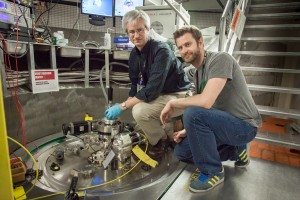 Doug Abernathy, left, ARCS instrument scientist at Oak Ridge National Laboratory, and Marc Janoschek, Los Alamos National Laboratory, prepare their sample for experiments at the Spallation Neutron Source. (Source: ORNL)