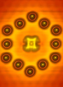 Image a  molecule centered within a hexagon assembled from twelve indium atoms on an indium arsenide surface. (Source: U.S. Naval Research Laboratory)