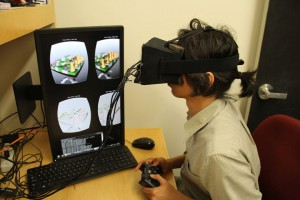 Fu-Chung Huang demonstrates the new light-field stereoscope virtual reality headset in the Stanford Computational Imaging Group lab. (Source: Stanford University)