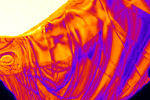 This is a false-colored ultrafast electron microscope snapshot of a thin crystal. The image was captured and lasted only a few femtoseconds. (Source: University of Minnesota)