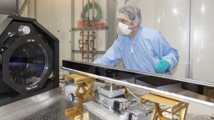 A scientist inspects a mirror for the XFEL project, which does not deviate from a perfect surface by more than a billionth of a meter. (Source: European XFEL)