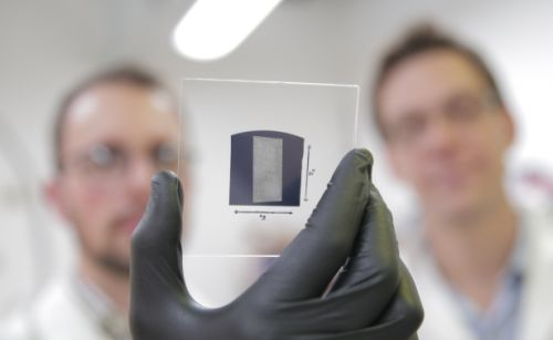 The UW–Madison engineers used a solution process to deposit aligned arrays of carbon nanotubes onto 1 inch by 1 inch substrates. The researchers used their scalable and rapid deposition process to coat the entire surface of this substrate with aligned carbon nanotubes in less than 5 minutes. (Source: Stephanie Precourt)