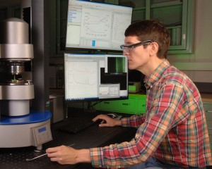 NIST researcher using the new rheo-Raman microscope (Source: NIST)