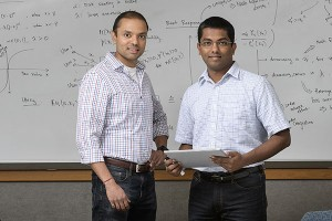 "Shreyas Sundaram, at left, an assistant professor in Purdue University's School of Electrical and Computer Engineering, and doctoral student Ashish Hota are performing research in game theory that harnesses the Nash equilibrium, developed by Nobel laureate John Nash, whose life was chronicled in the film ""A Beautiful Mind."" (Source: Purdue University)"